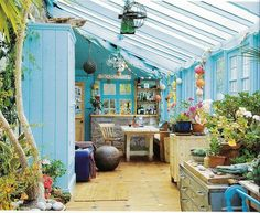 Such a pretty sunlit room - blue walls, tangled plants and ten kinds of pretty