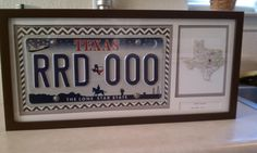 Matted and framed License Plate, with state, city, and years we lived there. (Places we have lived wall art). Cute! May do this with our old Louisiana plate.