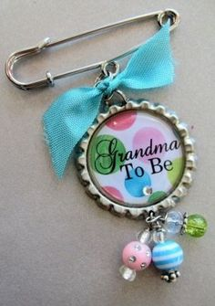 """Great idea - a """"grandma to be"""" pin for the mother's of the couple. Makes everyone feel included in the baby shower."""