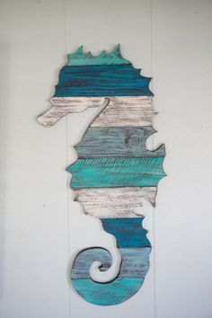 Wood Pallet Projects This is a seahorse made out of reclaimed pallet wood. You can have it as plain pallet wood, or hand painted by us to the colors of your Unique Home Decor, Home Decor Items, Diy Pallet Projects, Wood Projects, Pallet Ideas, Deco Marine, Wood Pallets, Pallet Wood, Pallet Walls