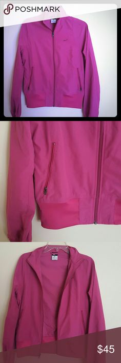 Nike Pink / purple NIKE zip up light wear jacket with two pockets.  Jacket is in excellent condition Nike Jackets & Coats
