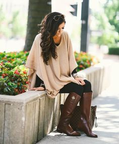 Blush poncho over all black with rich brown boots.