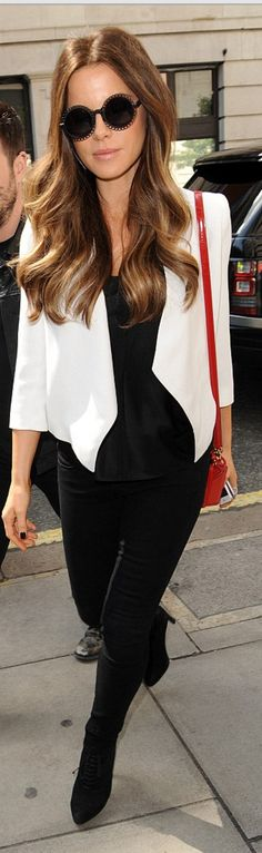 Kate Beckinsale: Sunglasses – Erdem  Jacket – Helmut Lang  Purse – Mark Cross  Shoes – Prada