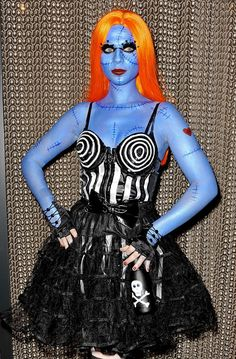 Michelle Trachtenberg blue body paint, orange wig, and crazy false lashes were key elements in her next-level creepy