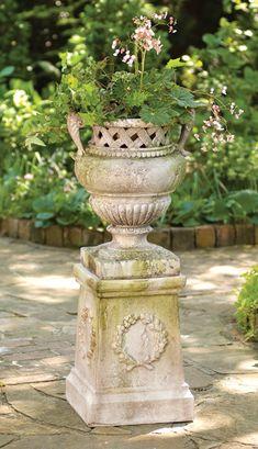 Basket weave detail on planter. Pedestal.