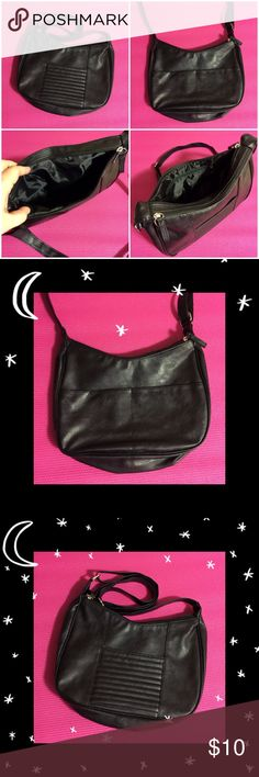 Black Pocketbook/ purse Nice black pocketbook, adjustable strap, 2 large compartments that zip up. Medium to large size purse. Excellent Condition- Smoke free home unknown Bags