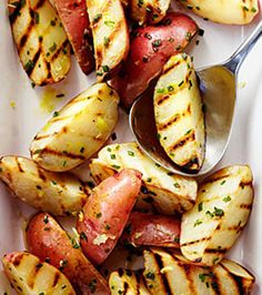 Grilled Lemon and Chive Potatoes - I would take this recipe and get rid of the olive oil, maybe use just water to steam grill them in the oven, and then toss with lemon juice, lemon zest, chives and salt... I just love the idea of lemon and chives on them-- like one would use on a baked potato, but more dispersed!