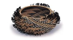 "Feathered Bowl c. 1877. Willow, bullrush, fern, feather, shells, glass beads. Height 5 1/2 "", diameter 12"", Philbrook Museum, Tulsa, Oklahoma."