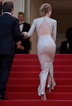 Emily Blunt working herself up the red carpet stairs in a super tight booty hugging gown