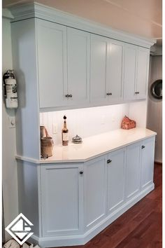 This dreamy custom hutch was just installed as part of a kitchen project. Finished in Satin White, these frameless maple cabinets are bright and inviting, giving off a warm welcome with under-cabinet lighting. The angles on the base of this unit and the multi-step moulding crowing the hutch give it a real depth of character, without becoming overwhelming or taking away from what is sure to be a practical workspace. Could you use a little extra storage and prep space in your kitchen, too?⠀