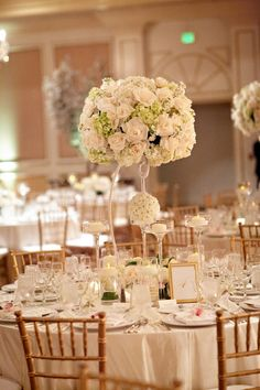 Norris Pavilion Inspiration - White flower and candle centerpieces.  www.mikiandsonja.com