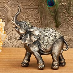 Spice up any centerpiece with this beautifully elegant Elephant Statue.