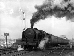"""LMS Patriot Class 5XP 4-6-0 5502 """"Royal Naval Division"""" on a Windermere-Crewe service making smoke while leaving Lancaster [9 April 1948]"""