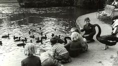1953: Children feed swans at the Royal Botanic Gardens. Picture: Herald Sun Image Library