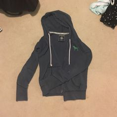 Pink zip up recycle hoodie (vintage (; ) It's old but still in pretty good condition! It has one little bleach stain(pictured) PINK Victoria's Secret Sweaters