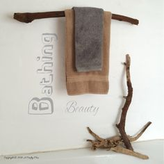 A towel rack made from a branch