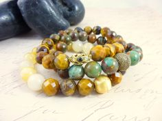 """Faceted Tiger Eye, """"Opal"""" Chalcedony, Yellow Jade stretch bracelets, cleansed and energy activated by EarthEnergyGemstones, $75.00"""