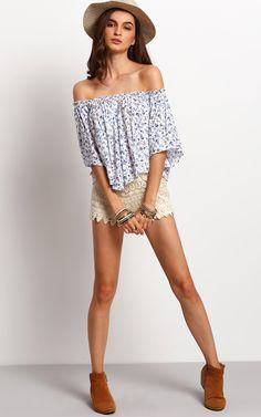This top is the cutest, staple summer piece. Show off your shoulders with this mini floral printed, beautifully cut top. Wear with a pair of cute shorts or simply a pair of jeans.