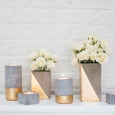 Find modern floral containers to add style to your home decor, like this tall Paradox ceramic upright rectangle vase in a gold and silver color block pattern with a geometric look. Fill with your favo