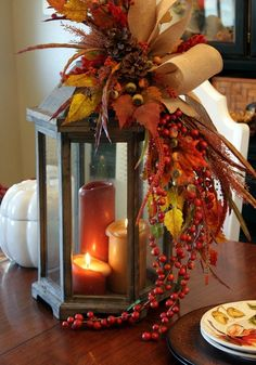 Fall themed centerpiece with candles and leaves