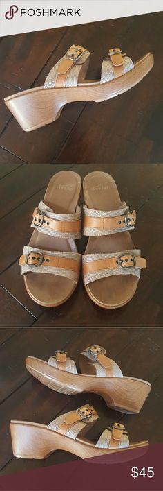 """Dansko Sandals Dansko Jessie leather sandals. Double banded slides with adjustable buckles to secure fit across the foot. Extremely comfortable and stylish! Very good pre-owned condition. Smoke-free home. 🦋💙 * Euro size 40 (9 1/2 - 10 US)  *2 1/2"""" heel. 1"""" platform Dansko Shoes Sandals"""