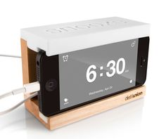 Love this alarm dock: slide in an iPhone and you've now got a giant snooze button right on top.