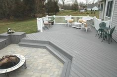 This is generally the color/stone patio look we are going for. White railing, gray floor.