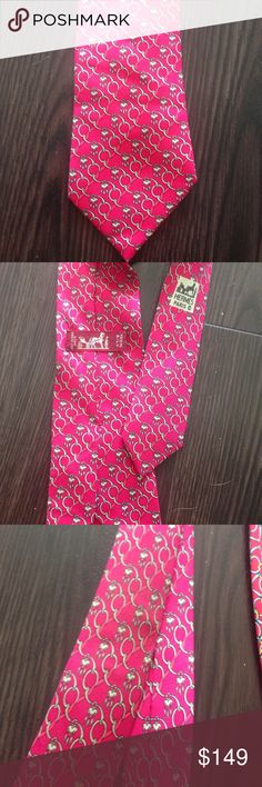 Authentic Hermes red tie Authentic great Thai. Gently used. Small stain in the third picture and the tag is a little loose on the back. This tire is more maroon but it looks hot pink in the picture Hermes Other