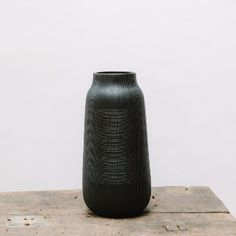 House Doctor Large Black Groove Ceramic Vase: A groove patterned black clay vase by the House Doctor. This makes a statement on it's own or filled with lovely blooms or a larger house plant.