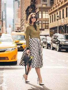 Organza cotton top, Nº21, $410. Gingham cotton skirt, Michael Kors, $1,295. Sunglasses, Céline, $480. Leather handbag, Fendi, $1,750. Leather pumps, Christian Louboutin, $675.   - ELLE.com