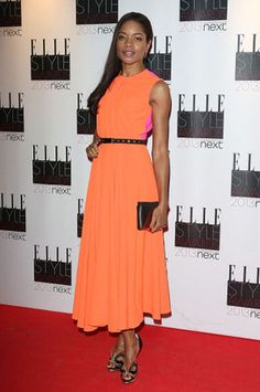 Bond actress Naomie Harris dressed to impress at the 2013 Elle Style Awards in a slimline Roksanda Ilinic dress from the Pre-Fall 2013 collection. The melon and hot-pink hues worked beautifully together, and Naomie styled her look with a cinching belt and Nicholas Kirkwood cut-out pumps.