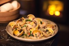 Sake is a Japanese rice wine, and it teams very well with seafood. Throw in fresh herbs and zingy ginger, and this quick clam recipe makes a fast and refreshing light meal. Clams Seafood, Seafood Dinner, Clam Recipes, Seafood Recipes, Sbs Food, Steamed Buns, All Vegetables, Snack Bar, Light Recipes