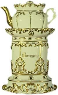 """Teapot #176  Oval white embossed with gold decorations in relief on stand and conforming pot. Rococo base """"Bon Soir, Bonne Nuit"""" on sides of stand.  Acquired in Poitiers"""
