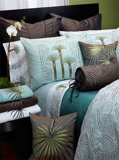 Anali's Beach Palm Collection - The Beach Palm embroidered bed linens represent a deco take on the popular motif. Blue toned palm trees are embroidered on eucalyptus and white sateen and are accented with the Paris embroidered duvet cover in charcoal thread. Deco corded back pillow and Palmetto decorative pillows complete the look. All sateen is 300 thread count Egyptian Cotton from Italy.
