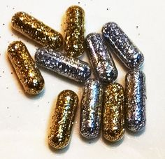 Check out this item in my Etsy shop https://www.etsy.com/listing/258167514/gold-and-silver-glitter-pills-gold