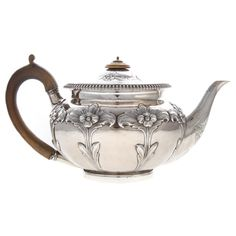 Robert Garrard I, London, typical round form, with foliate capped treen handle, with later Victorian repousse f. on Jan 2018 Vintage Tea, Vintage Silver, Antique Silver, Teapot Crafts, Silver Teapot, Tea Culture, Silver Work, Teapots And Cups, Gold Glass