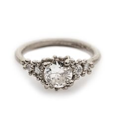 A unique and timeless solitaire diamond engagement ring featuring a beautiful antique cut white diamond in white gold, handmade in our London studio.