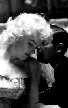 Marilyn Monroe, pictured here with Milton Berle, attending a party given in the honor of the New York Friars Club at the Waldorf Astoria, 1955.