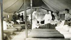 A nursing sister is assisting a doctor in a ward at the tent hospital. She is holding out a tray for him to take medical tools from. Canadian Army, Doctor In, World War One, Sisters, Medical, Nurses, Wwii, Blankets, Tent
