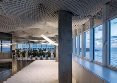 In the new office, the product is used to create a billowing ceiling intended to reference undulating forms of a cloudy sky and the ocean, both of which are visible through the windows.