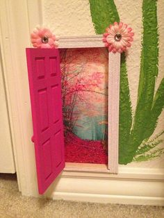 """A fairy door wilt a painted wall. This one was used as a """"tooth fairy"""" door."""