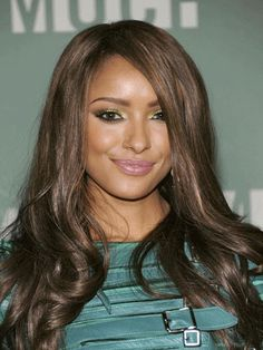 Get Kat Graham's glow by using a bronzer that's only a shade or two lighter than your skintone. Then blend a creamy blush onto the apples of your cheeks.