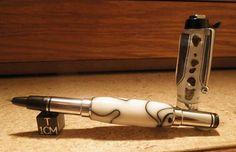 Custom GSI pen - has 6 meteorite samples inlaid in the top.  Made by Jack's Pens for Galactic Stone & Ironworks.