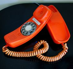 Orange Rotary Phone 1970s-oh my gosh I had this very phone when I got my first apartment, along with a yellow, pink and white trimline as they were called!