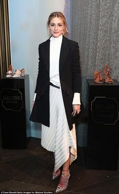 City chic: American socialite Olivia Palermo also attended the presentation donning a fashionable monochrome outfit with an asymmetrical hemline detail