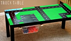 To make this changeable: paint the roads on a canvas the same size as the table top. You could hang the canvas on the wall when not in use. Also make a few different play scenes to change out.