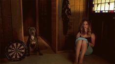 cinemagraph animated gif of girl with dog and dartboard