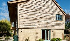 Very well fitted waney-edge elm cladding