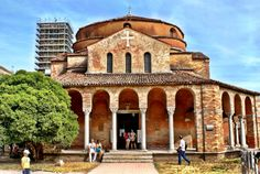 View of #cathedral of Santa Maria Assunta which is located in Torcello. #Torcello is an island which is located in Northern end of Venetian Lagoon. Its nearby city is #Venice .