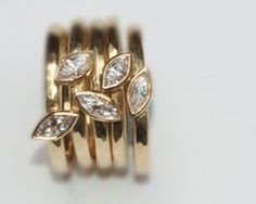 Marquise shaped diamond, 18 carat yellow gold stacking rings.